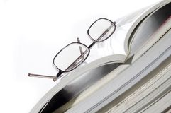 Books and reading glasses stock photo