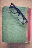 Books and reading glasses on vintage Burlap background with Inst Royalty Free Stock Photos