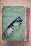 Books and reading glasses on vintage Burlap background with Inst Stock Photo