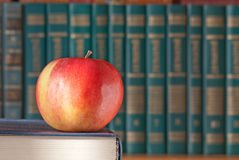 Books and red apple Stock Photography