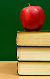 Books and red apple Royalty Free Stock Image