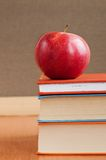 Books And Red Apple Stock Photos