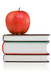 Books with a red apple on the top Stock Images