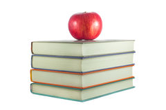 Books with red apple on a white background Royalty Free Stock Photos