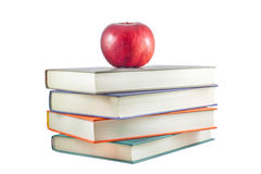 Books with red apple on a white background Royalty Free Stock Photography