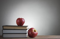 Books and red apples Stock Image