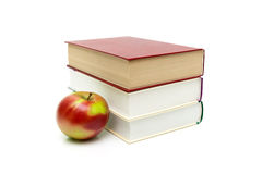Books and ripe apple on a white background Royalty Free Stock Image