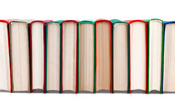 Books in row. On white background stock image