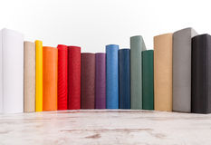 Books. A row of different books in different colors Stock Photos