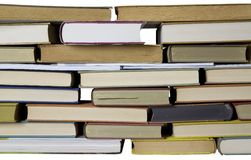 Books in a row isolated. Books in a horizontal row, isolated on white backgrond, clipping path Stock Photo