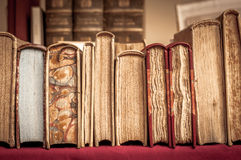 Books in a row Stock Images