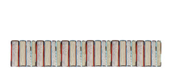 Books in a row. Lot of books in a row on white background stock photo