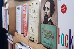 Books for sale. LONDON, UNITED KINGDOM - CIRCA FEBRUARY 2012 - a book that illustrates the works of Charles Dickens is on sale in a bookstore stall located in Royalty Free Stock Photo