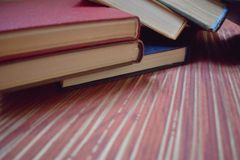 Books scattered over the table stock image