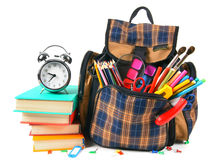Books, school accessories and a backpack. Stock Photos