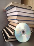 Books in semicircle.  And disk On desk. Royalty Free Stock Images