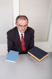 Books. Senior businessman with books in office Royalty Free Stock Photography