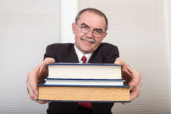 Books. Senior businessman with books in office Stock Photo