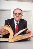 Books. Senior businessman with books in office Royalty Free Stock Image