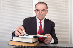 Books. Senior businessman with books in office Royalty Free Stock Photos