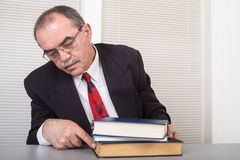 Books. Senior businessman with books in office Royalty Free Stock Images