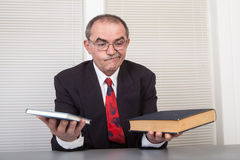 Books. Senior businessman with books in office Royalty Free Stock Photo