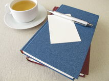 Books, sheet of paper and tea Royalty Free Stock Photo