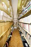 Books on the shelf. Books and papers on the shelf royalty free stock images