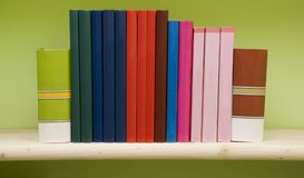 Books on a shelf. Colorful books in a row on a shelf Stock Image