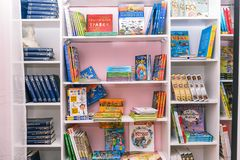 Books on the shelf. Blurred image of bookshelves. School class with books. Educational institution, library, bookstore royalty free stock photography