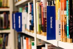 Books on Shelf in Library Stock Photo