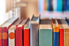 Books on a shelf in the library Stock Images