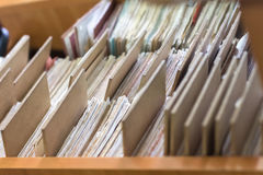 File folders in a file cabinet, card catalog in a library, closeup stock photography