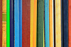 Books in shelf. A row of neutral books in shelf Stock Photography