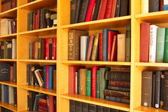 Books in shelves. Bookcases with lots of books on the shelves stock photo