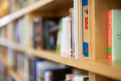 Books on shelves. In a public library with selective focus Royalty Free Stock Images