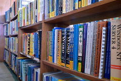 Computer books on the shelves Stock Photos