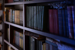 Books shelves. At home library. Selective focus Stock Photography
