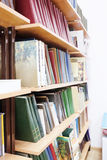 Books on a shelves in a library Stock Images