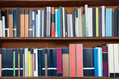 Books on the shelves of a library. Several books on the shelves of a wooden library Stock Photos