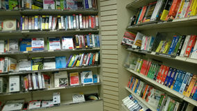 Books on shelves selling at store Royalty Free Stock Image