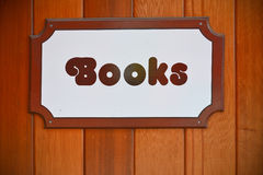 Books shop sign. Hanged on a wooden wall Royalty Free Stock Photos