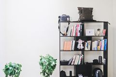 Books and Speakers on Black Wooden Shelf Royalty Free Stock Image