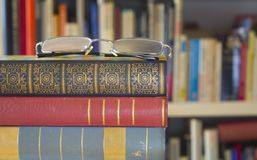 Books with spectacles, library concept Stock Photo