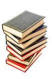 Books stack. A vertical pile of books with shadow on white background royalty free stock image