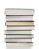 Books Stack. High stack of books isolated on white stock image