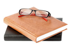 Books stack with eyeglass Royalty Free Stock Images