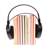 Books stack and headset isolated Stock Image
