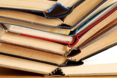 Books stack. Old dusty opened books stack on table Royalty Free Stock Photos