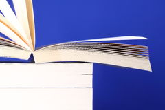 Books stacked. Photograph of stacked books on a blue background Stock Photo